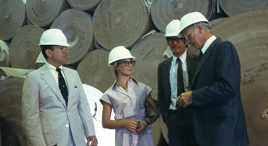 Photo depicts Claudia Huntington and other analysts on a research visit to United States Gypsum Company's plant in Stony Point, New York, circa 1980.