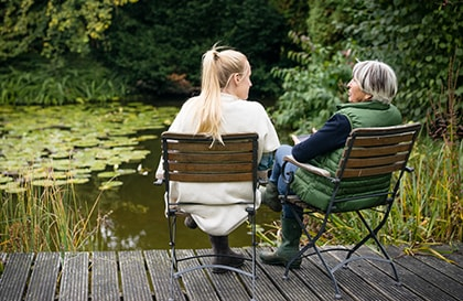 Older woman and young woman sitting together